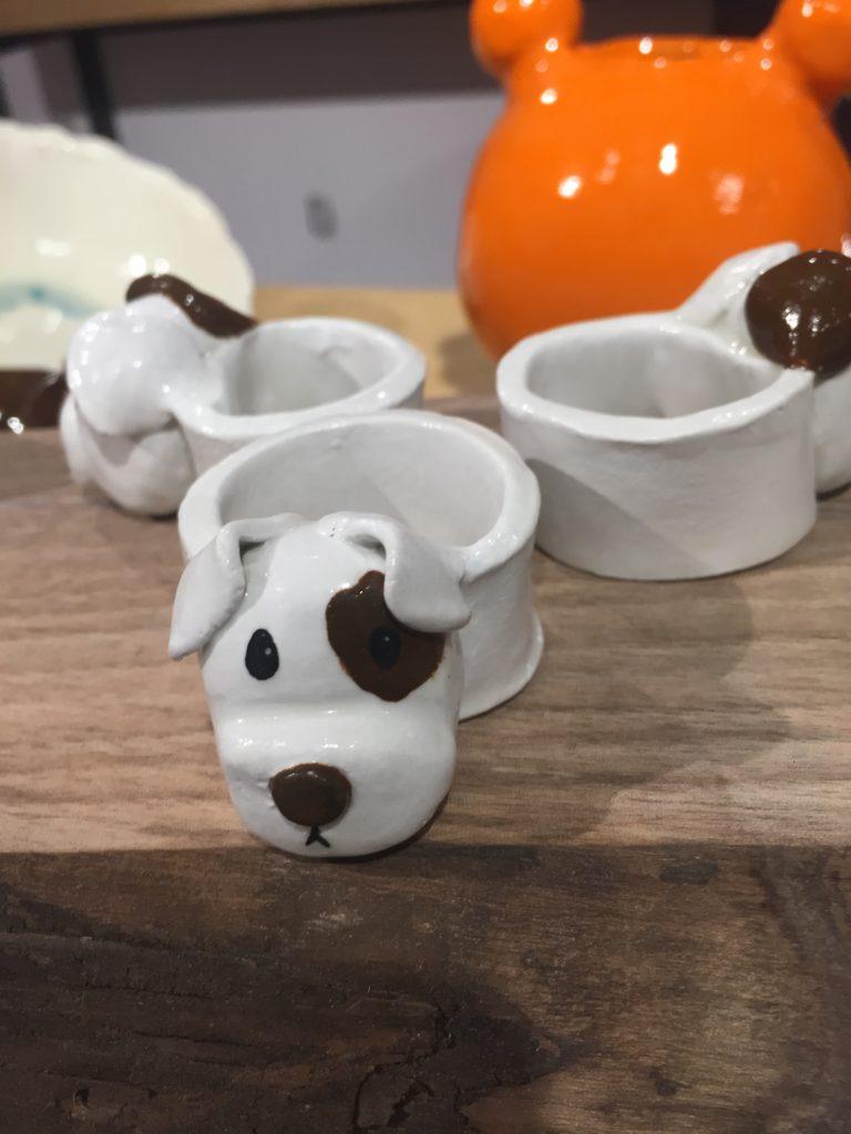 Three ceramic napkin rings in the shape of Dalmatian dogs