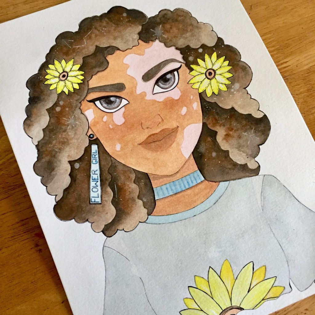 A watercolour of a smiling Black woman with vitiligo. She has yellow flowers in her hair and a yellow flower on her grey shirt. She is wearing blue earrings and a blue choker.