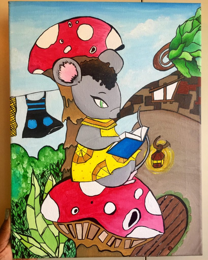 An acrylic painting of a grey mouse reading a blue book, sitting on top of a red mushroom house. The mouse has on a yellow dress. In the background there is a line of clothing, surrounded by green leaves.
